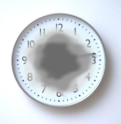 Image Of A Clock Depicting Macular Degeneration Symptoms In An Eye Exam In Brooklyn, NY - Brighton Eye Associates